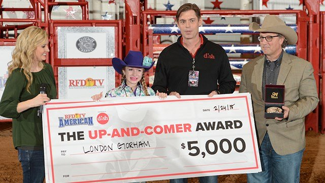 London Gorham receives the Up-And-Comer award with RFD-TV's Amy Wilson, DISH CMO Jay Roth and RFD-TV's Sean Cassidy.
